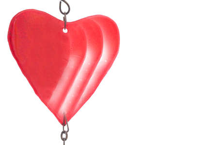 Christmas shiny red heart on white background. No people