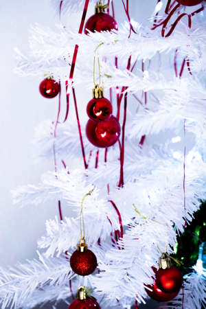 White christmas tree with red decorations. No people 写真素材