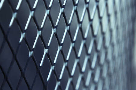 Grating with defocused rhombus shaped background. No people Stock Photo