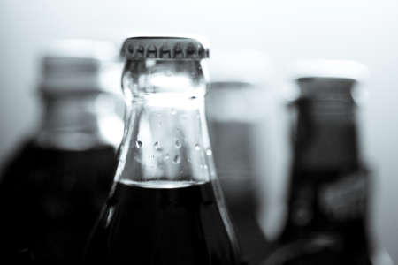 Top of a glass bottle of various soft drinks. No people Stock Photo