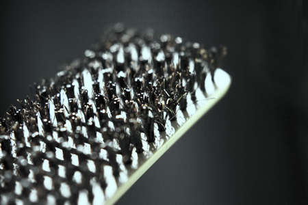 Hair brush with plastic bristles for straightening hair. No people