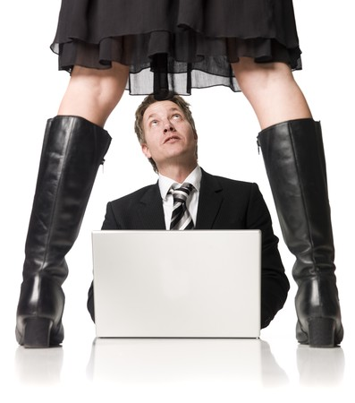 Man with a computer afraid of his female boss Stock Photo - 4930111
