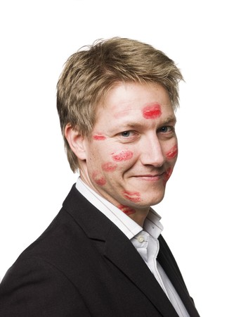 Man with lipstickmarks in his face photo