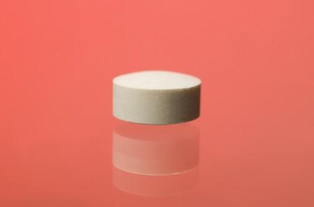 pastil: Pill toward red background