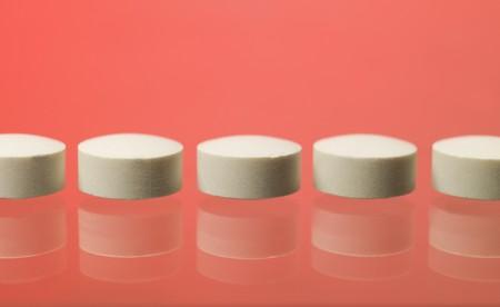 pastil: Pills toward red background