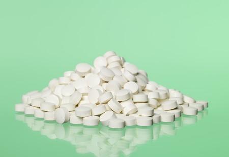 pastil: Stack of pills towards green background