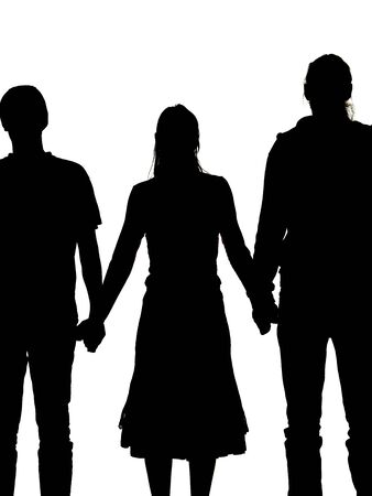 cohesiveness: silhouette of a woman and two men holding hands Stock Photo