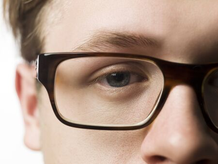 short focal depth: man with glasses