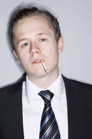 Young man smoking photo