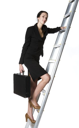 buisness: Buisness lady climbing up a ladder Stock Photo