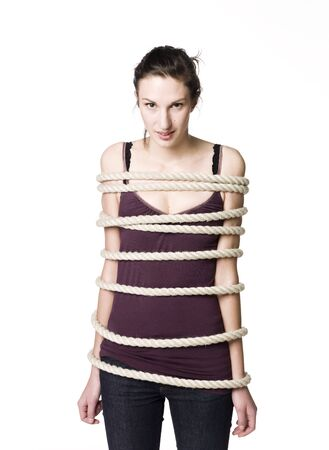 Tied up woman Stock Photo