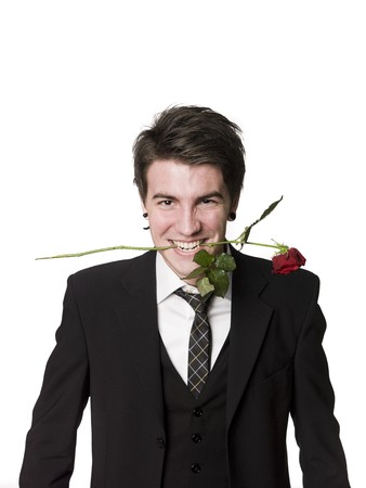 Man with a rose in his mouth photo