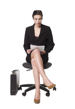 buisness: Buisness woman sitting on a chair