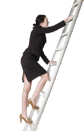Woman climbing up the ladder photo