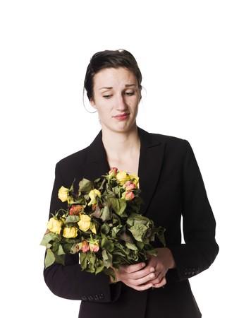 dead flowers: Woman with dead flowers