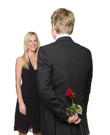 Man with a rose behind his back and a happy woman Stock Photo - 4397226