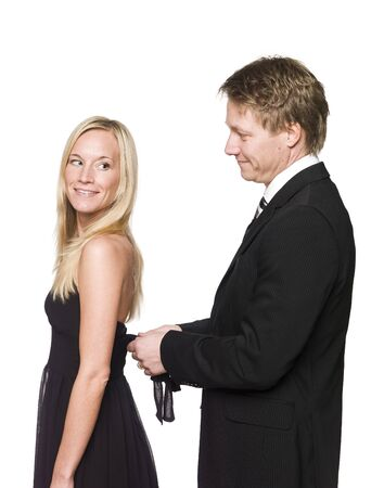 man helping woman to get dressed Stock Photo - 4397405