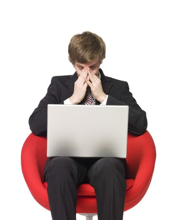 Depressed man with a laptop photo