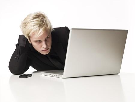 saddened: Man reading on a computer Stock Photo