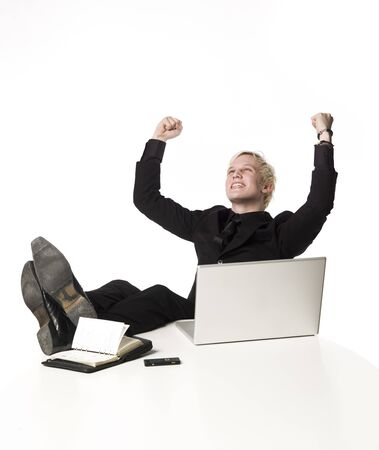 almanac: Happy boy siting infront of a computer Stock Photo