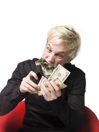 dollarbill: Man eating money Stock Photo