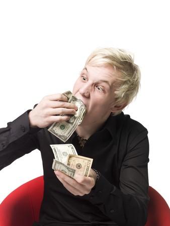 Boy eating money photo