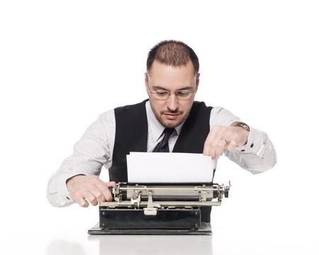 Man writing on a vintage typewriter photo