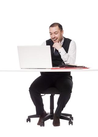 Man behind a desk photo