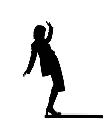 Silhouette of a woman close to fall down Stock Photo - 4436357