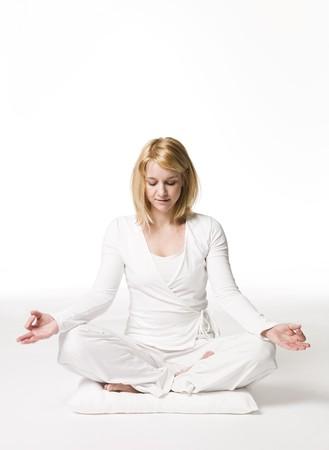 yoga pillows: Woman meditating Stock Photo