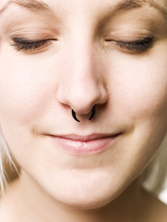 nosering: Close up of a piercing in the nose Stock Photo