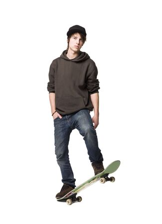 ni�o en patines: Ni�o con una patineta