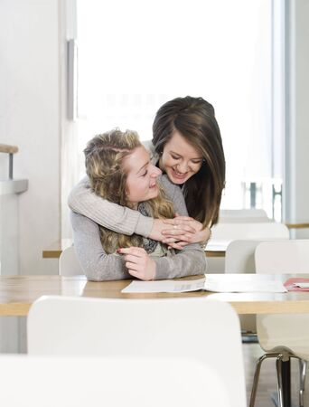 two girls hugging: two girls hugging Stock Photo