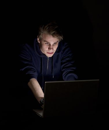 man infront of a computer photo
