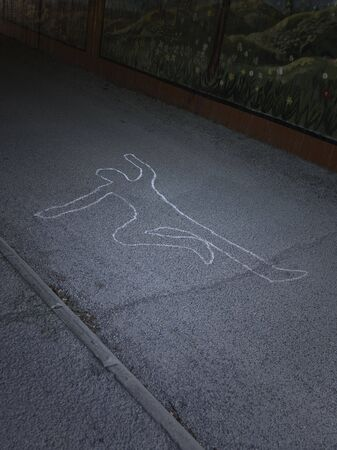 woe: Contour of a person drawn at the asphalt