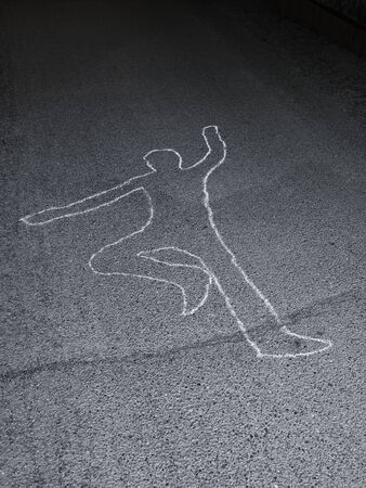 scene of a crime: Contour of a person drawn at the asphalt