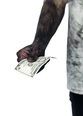 short focal depth: Dirty hand holding a five dollar bank note Stock Photo