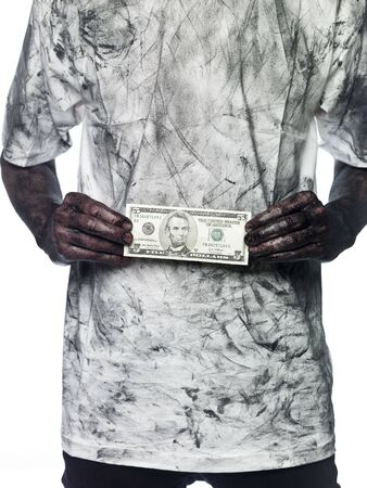 Very dirty person holding a five dollar bank note Stock Photo