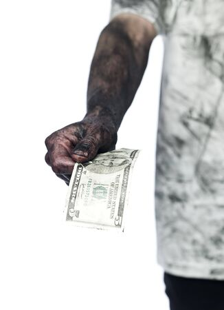 Dirty hand holding a five dollar bank note Stock Photo