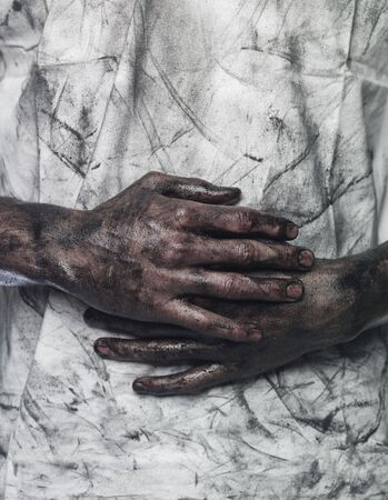 very dirty: Very dirty hands in front of a dirty shirt Stock Photo