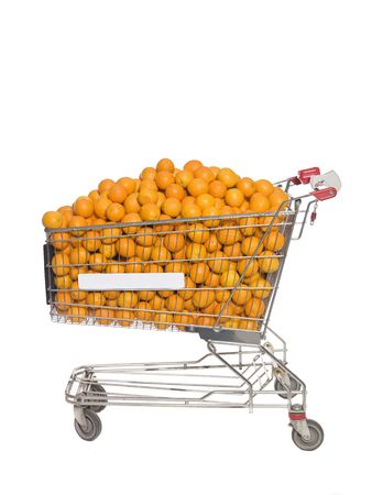 Shopping Cart with oranges isolated towards white background photo
