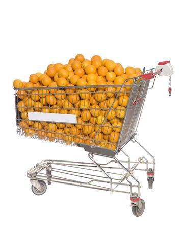 Shopping cart with oranges isolated towards white background photo