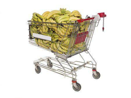 Shopping cart with bananas isolated towards white background photo