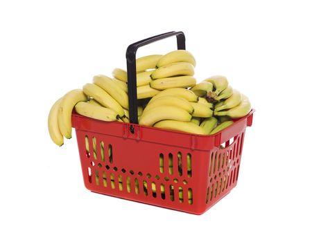 Shopping basket with bananas isolated towards white background photo