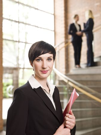 Businesswoman in front of two women in the stairs photo