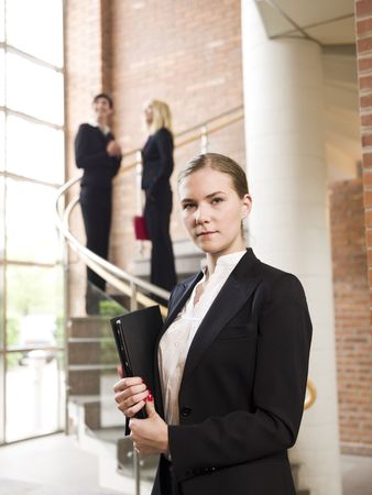 Businesswoman in front of two other women photo