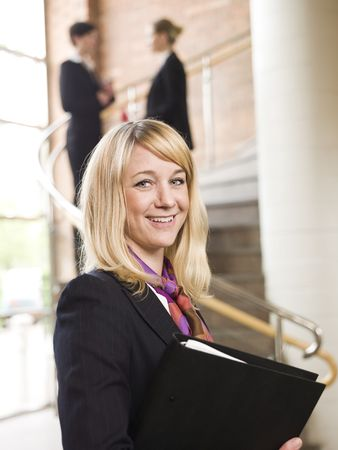 Happy businesswoman with a folder photo