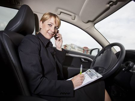 Businesswoman working in her car photo
