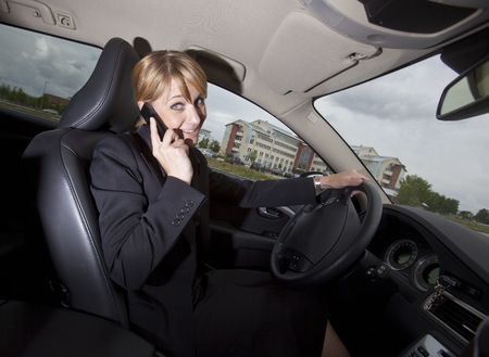 Woman on the phone when she driving her car photo