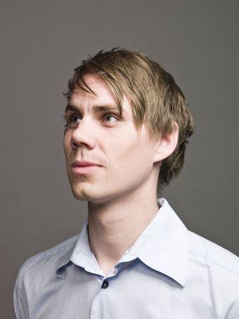sidewards: Portrait of a man in profile looking sidewards Stock Photo